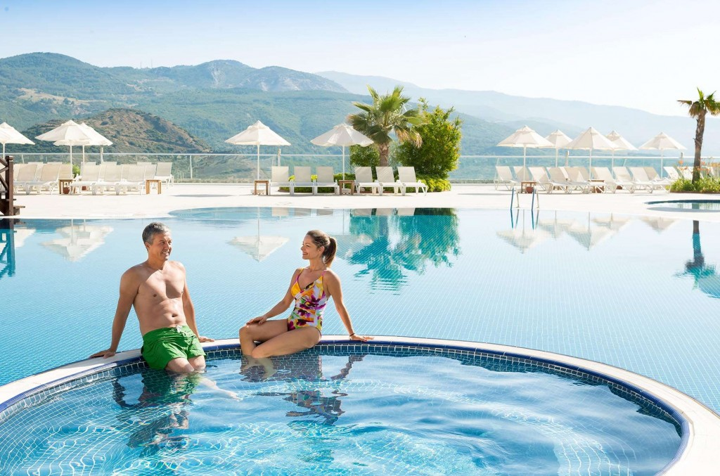 Relaxing by the pool at Kusadasi Golf & Spa under the summer sun
