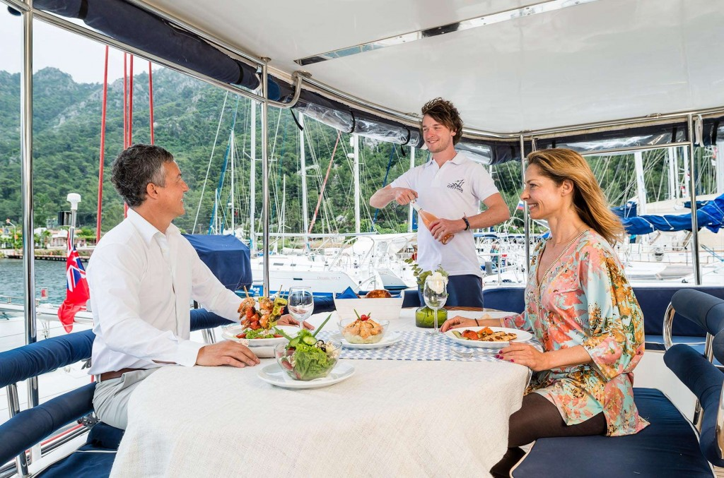 Guests being served a delicious meal on the CLC Yacht