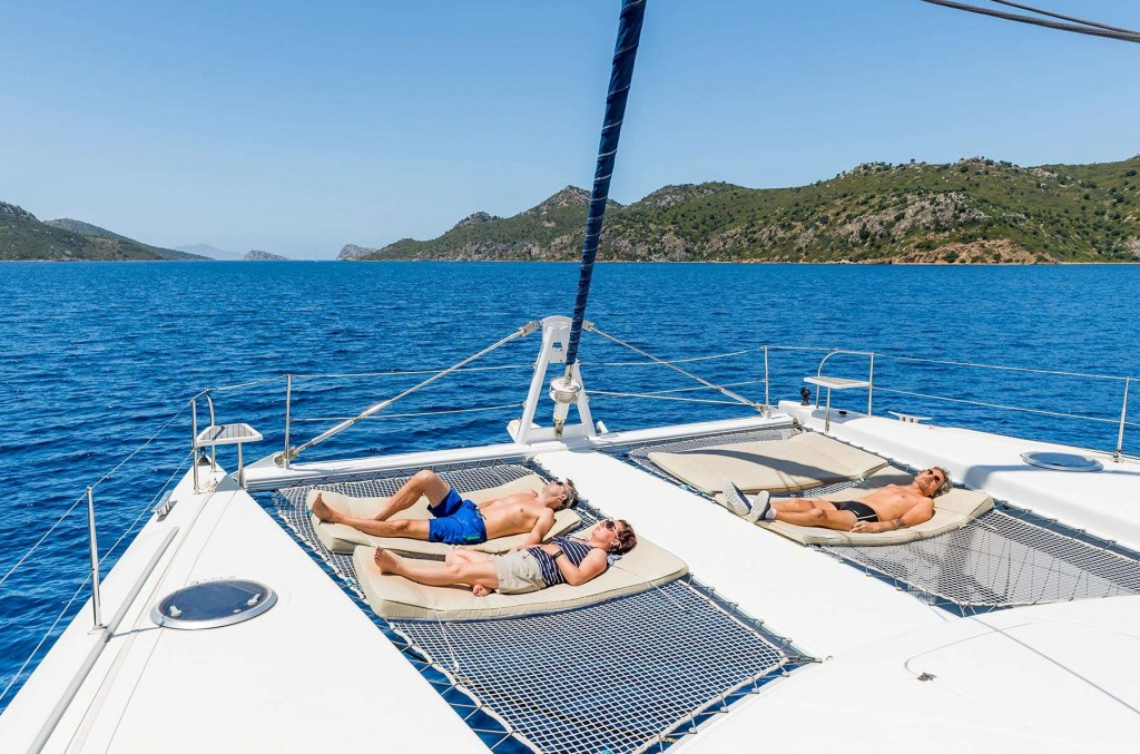 Guests enjoying the sun from the CLC Yacht deck