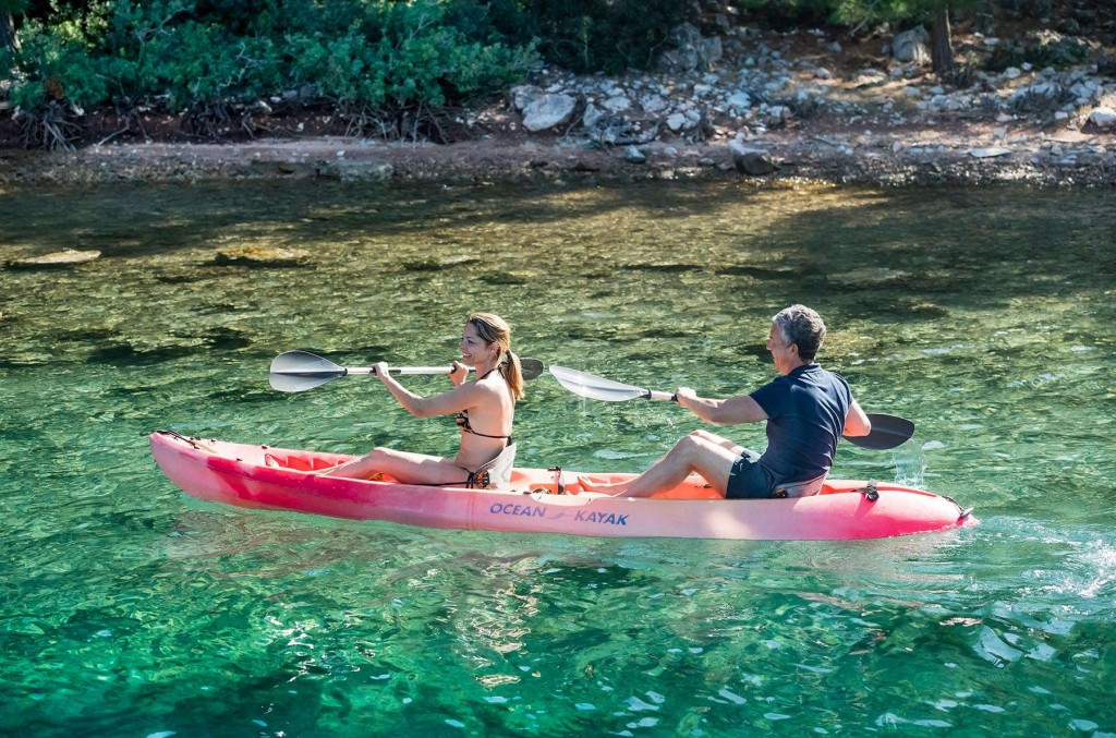 Guests kayaking near the coast